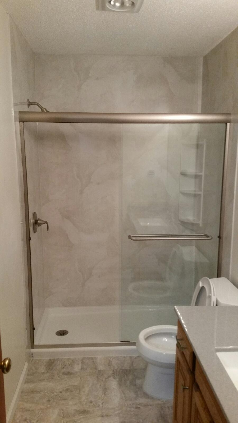 AFTER - New Acrylic Walk-in Shower in Silver White Marble Smooth Surround with White Acrylic Shower Pan.  New flooring is Congoleum Duraceramic Roman Elegance: Light Greige (RE-43) and new Vanity Top