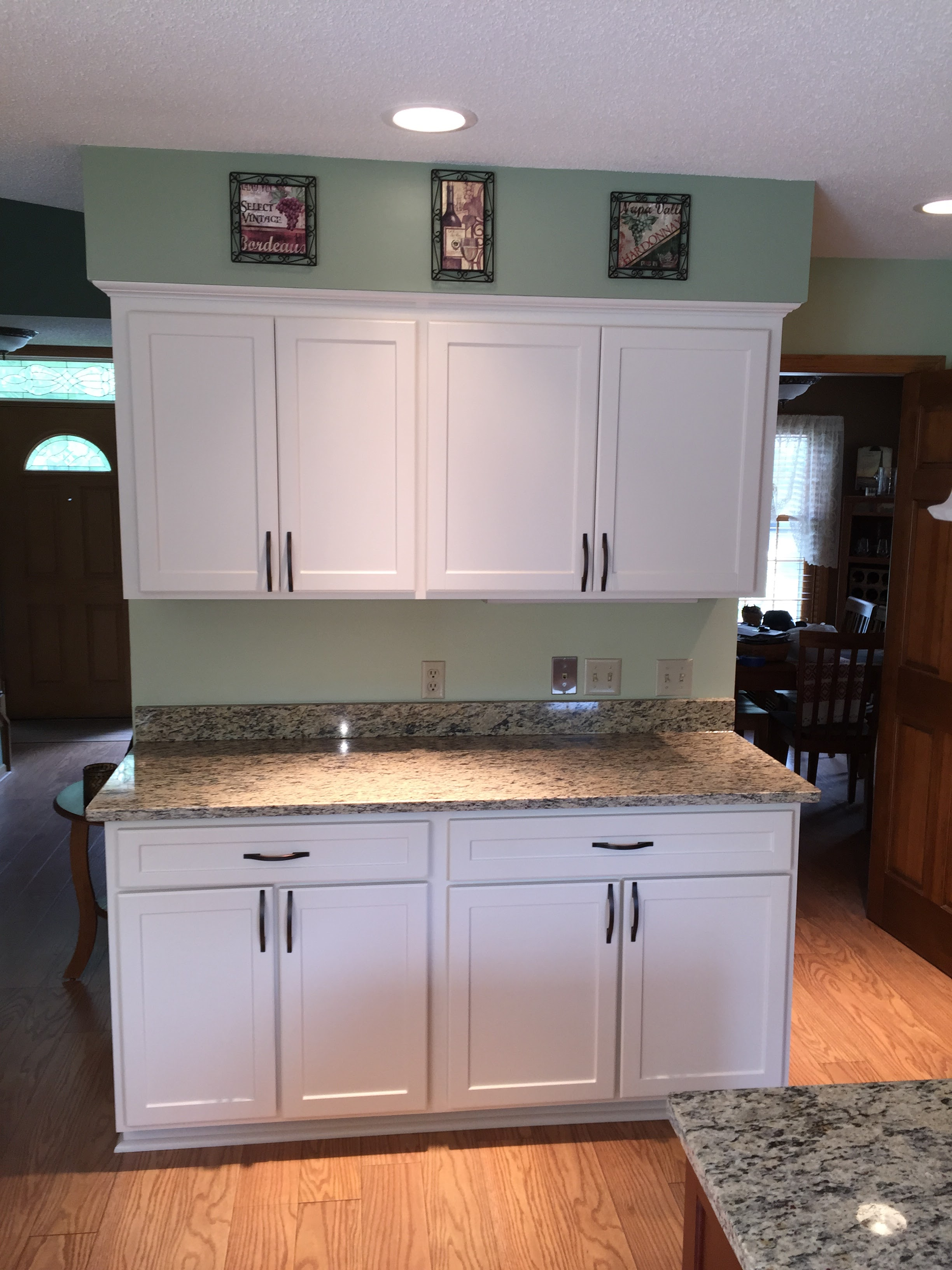 AFTER - Beautiful newly refaced cabinets in a modern, easy-to-clean and maintain White finish