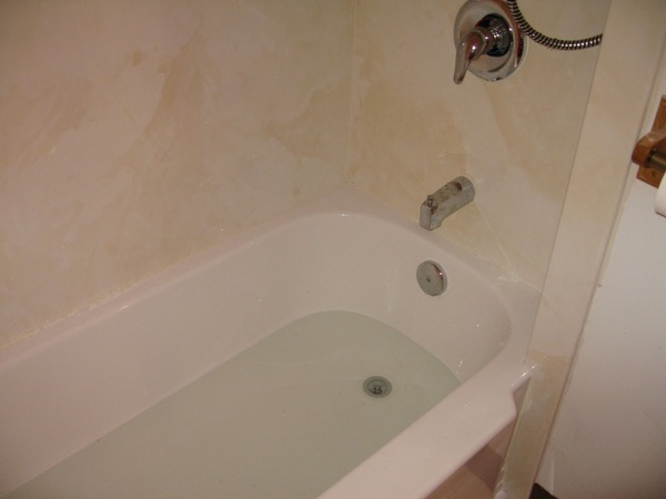 AFTER - A beautiful, easy to clean and maintain Bath Planet acrylic tub and surround were installed